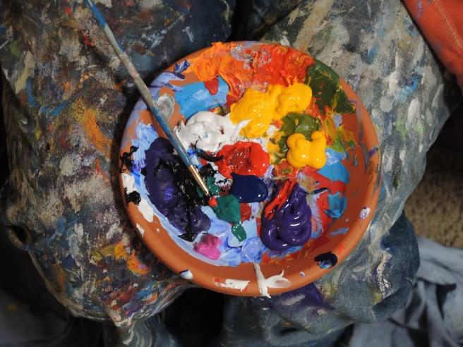 Paint pot filled with coloured paints.jpeg